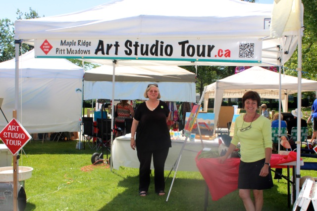 Kerry & Kristen showing off our new banner at the Haney Farmers Market July 6/13